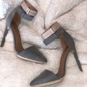 Grey and tan high heels with double ankle strap.